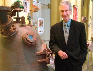 Hugh Karraker, great grandson of Leo Baekeland, with a replica Bakelizer.