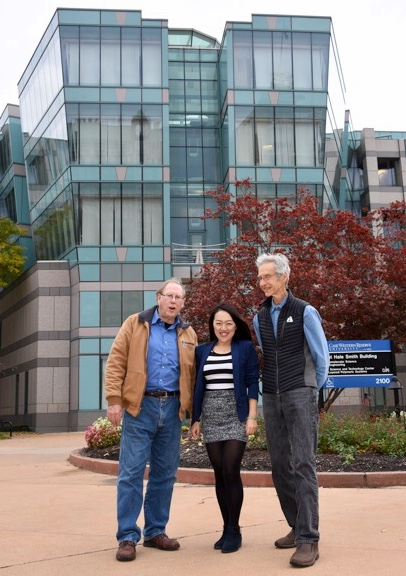 John E. Maher, Dr. Lu Han, Hugh Karraker in front of the fabulous Macromolecular Science and Engineering Building