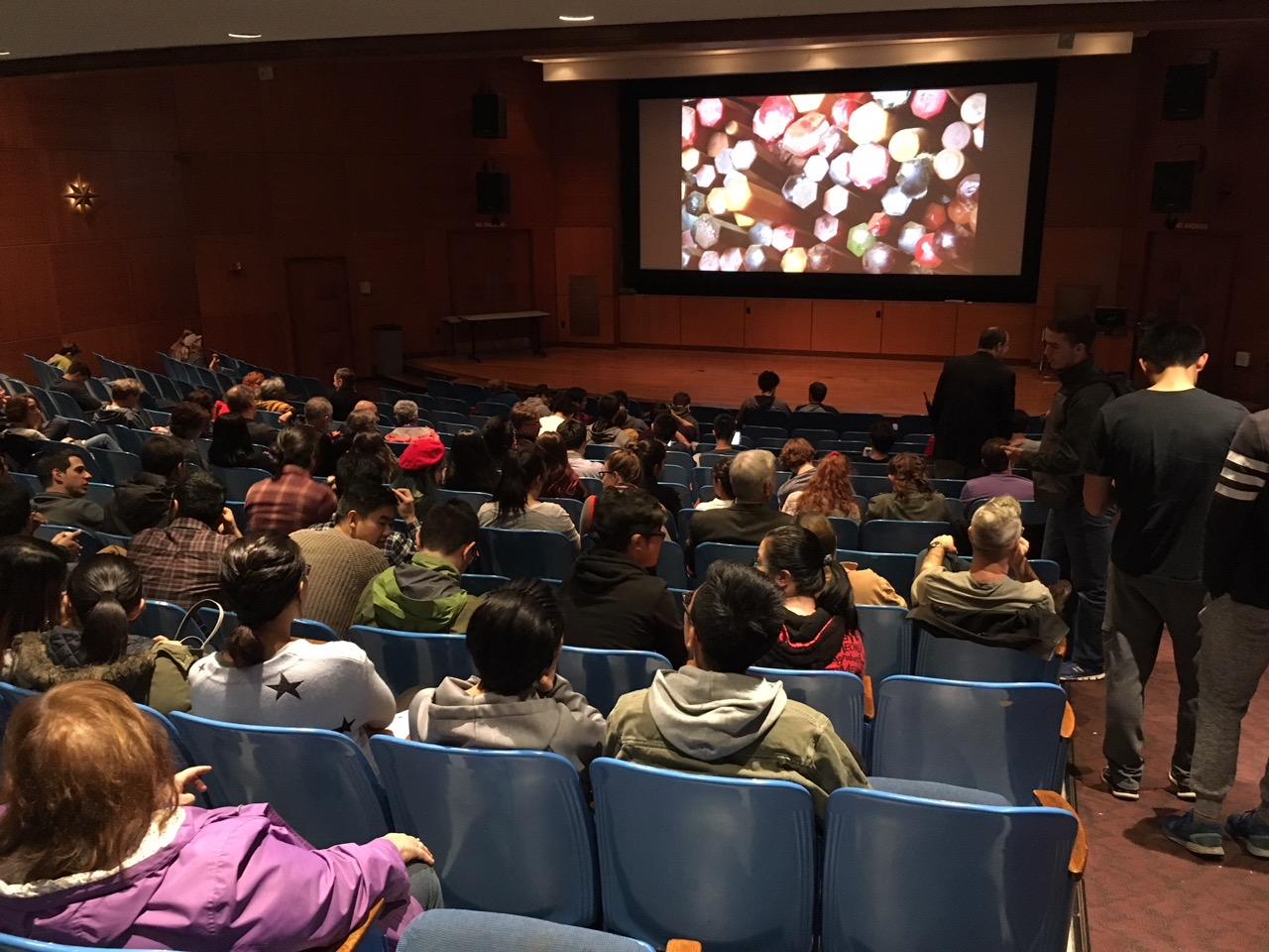 Audience taking their seats in Strosacker Auditorium