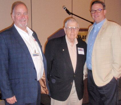 Glenn flanked by Chairman of the Conference, Larry Whitemore of Stoner Molding Solutions and Russ Broome of PLASTICS